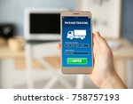 woman tracking parcel with help ... | Shutterstock . vector #758757193