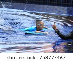 asian boy gets swimming lessons ... | Shutterstock . vector #758777467
