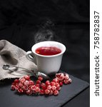 hot tea from red viburnum in a