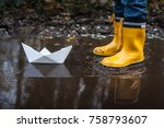 child with yellow rain boots... | Shutterstock . vector #758793607