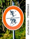 Small photo of luger and skier warning sign