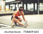female runner stretching and... | Shutterstock . vector #758809183