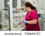 Small photo of Moscow Region, Mytischi, City Clinical Hospital, May 25, 2017. Doctor examines a premature baby in a special incubation box