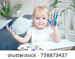 portrait of little girl playing ...   Shutterstock . vector #758873437