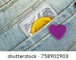 yellow condom in blue jeans... | Shutterstock . vector #758902903