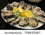 fresh oysters and lemon on...   Shutterstock . vector #758933587