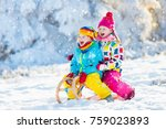 little girl and boy enjoying... | Shutterstock . vector #759023893