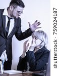 Small photo of Very angry boss angry on a new employee and she is shocked (Business, gender, subordination, work concept)