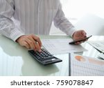 Small photo of Businessman reviewing data in financial statement and assessment business. Accounting , Accountancy, Bookkeeping Concept.