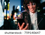 smiling gorgeous girl browsing... | Shutterstock . vector #759140647