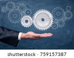 a businessman's hand holds two... | Shutterstock . vector #759157387