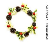 Small photo of Christmas wreath of holly-olive leaves, pinecones, and Alpinia formosana nuts