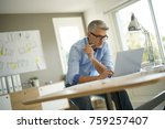 architect in office working on... | Shutterstock . vector #759257407