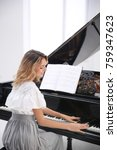 Talented Woman Playing Piano...