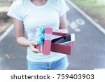woman discovers a smartphone in ... | Shutterstock . vector #759403903