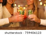 young men and women drinking... | Shutterstock . vector #759406123