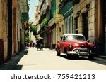 Red old car in the streets of Havana Cuba