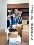 couple kissing while unpacking... | Shutterstock . vector #759458113