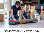 couple unpacking moving boxes... | Shutterstock . vector #759458737