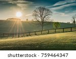 Small photo of Sun Shines Over Rolling Kentucky Field at Dawn