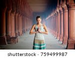 girl meditates hands folded in... | Shutterstock . vector #759499987