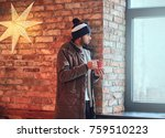 a man drinks coffee. | Shutterstock . vector #759510223