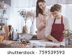 granddaughter enjoying cooking... | Shutterstock . vector #759539593