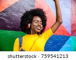afro woman listening to music | Shutterstock . vector #759541213