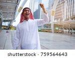 handsome arab businessman happy ... | Shutterstock . vector #759564643