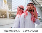 portrait of happy arabian using ... | Shutterstock . vector #759564703
