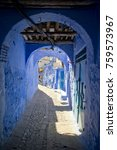 Small photo of Alleyway in Morocco's Blue City, Chefchaouen