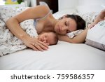 young mother sleeping with her... | Shutterstock . vector #759586357