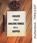 Small photo of Motivational and inspirational quotes - I believe that amazing things will happen wording on a notebook. With vintage styled background of wooden table.