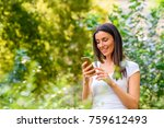 a cheerful woman in a park... | Shutterstock . vector #759612493
