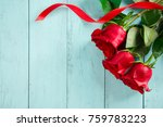 red roses with a red ribbon on... | Shutterstock . vector #759783223