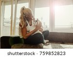 young woman and cat on sofa in... | Shutterstock . vector #759852823
