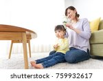 mother tieing child's hair... | Shutterstock . vector #759932617