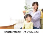 mother tieing child's hair... | Shutterstock . vector #759932623