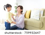 mother tieing child's hair... | Shutterstock . vector #759932647