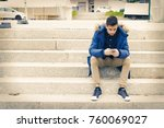 young adult with mobile phone...   Shutterstock . vector #760069027