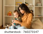 young mother playing with... | Shutterstock . vector #760273147
