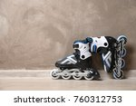 pair of roller skates on floor... | Shutterstock . vector #760312753
