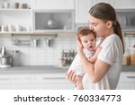 young mother holding baby in... | Shutterstock . vector #760334773
