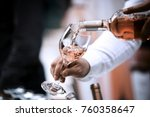 Stock photo bottle and wine glass rose 760358647