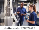 Small photo of Engineer Showing Apprentice How To Use CNC Tool Making Machine
