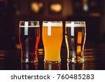glasses of light and dark beer... | Shutterstock . vector #760485283