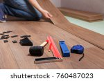 man laying laminate flooring.... | Shutterstock . vector #760487023