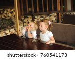 little boy and girl drinking... | Shutterstock . vector #760541173