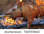 suckling pig on a rotating spit ... | Shutterstock . vector #760555063
