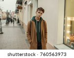 handsome young stylish man with ... | Shutterstock . vector #760563973